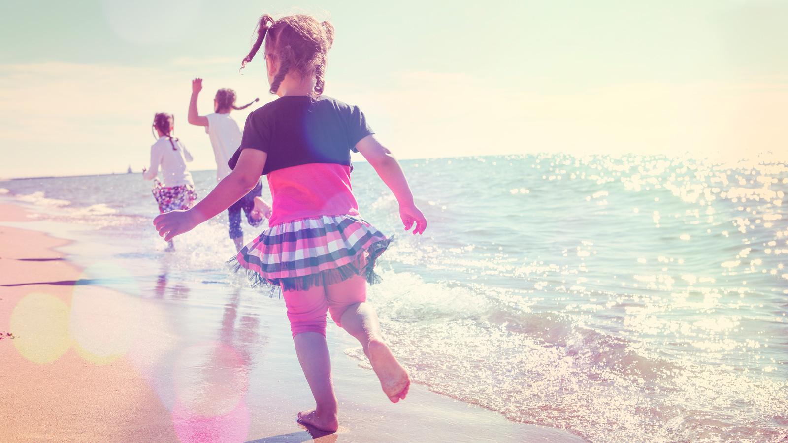 bigstock-Children-running-on-the-beach--79103224